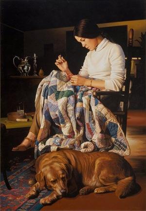 Девушка шьет одеяло